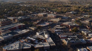 DX0001_002051 - 5.7K stock footage aerial video of railroad tracks separating office buildings and warehouses in Fort Collins, Colorado