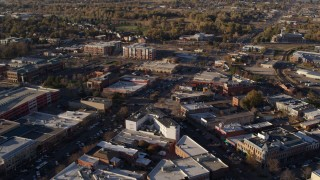 DX0001_002052 - 5.7K stock footage aerial video of shops and office buildings in foreground near apartment buildings in Fort Collins, Colorado
