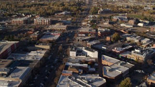 DX0001_002053 - 5.7K stock footage aerial video of shops and office buildings around wide street in Fort Collins, Colorado