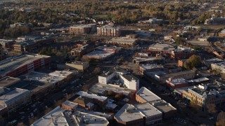 DX0001_002054 - 5.7K stock footage aerial video orbit shops and office buildings by wide streets in Fort Collins, Colorado