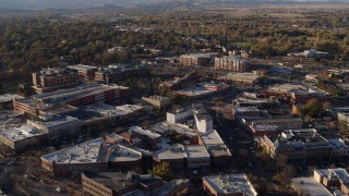 DX0001_002055 - 5.7K stock footage aerial video fly away from and flyby shops and office buildings by wide streets in Fort Collins, Colorado