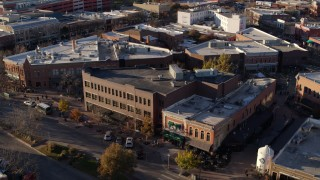 DX0001_002057 - 5.7K stock footage aerial video orbit a shop with green awning and brick office building in Fort Collins, Colorado