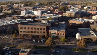 DX0001_002058 - 5.7K stock footage aerial video passing a shop with green awning and brick office building in Fort Collins, Colorado
