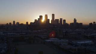 DX0001_002063 - 5.7K stock footage aerial video flyby the city's skyline as the sun rises in Downtown Minneapolis, Minnesota