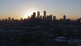DX0001_002067 - 5.7K stock footage aerial video of the city's skyline as the sun rises in Downtown Minneapolis, Minnesota during descent