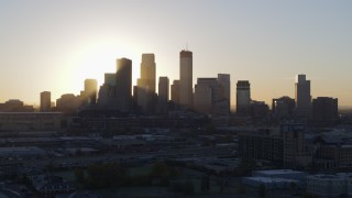 DX0001_002071 - 5.7K stock footage aerial video a slow ascent while focusing on the city skyline at sunrise in Downtown Minneapolis, Minnesota