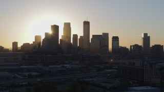 DX0001_002076 - 5.7K stock footage aerial video focus on city skyline at sunrise during slow pass in Downtown Minneapolis, Minnesota