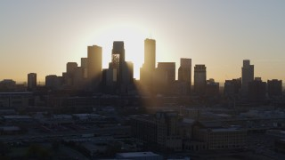 DX0001_002078 - 5.7K stock footage aerial video ascend and fly away from city skyline at sunrise in Downtown Minneapolis, Minnesota