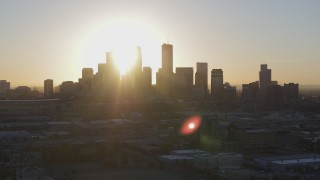 DX0001_002079 - 5.7K stock footage aerial video of the rising sun behind the city skyline in Downtown Minneapolis, Minnesota