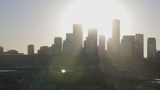 DX0001_002086 - 5.7K stock footage aerial video passing by the city's skyline at sunrise in Downtown Minneapolis, Minnesota