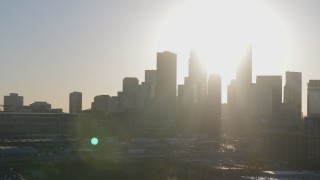 DX0001_002087 - 5.7K stock footage aerial video descend and flyby the city's skyline at sunrise in Downtown Minneapolis, Minnesota