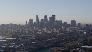 DX0001_002091 - 5.7K stock footage aerial video slowly flying by the city's downtown skyline at sunrise in Downtown Minneapolis, Minnesota