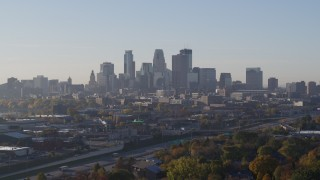 DX0001_002092 - 5.7K stock footage aerial video slowly flying by the city's downtown skyline during descent at sunrise in Downtown Minneapolis, Minnesota