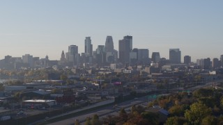DX0001_002093 - 5.7K stock footage aerial video slowly ascend and flyby the city's downtown skyline at sunrise in Downtown Minneapolis, Minnesota