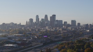 DX0001_002094 - 5.7K stock footage aerial video slowly flyby the city's downtown skyline at sunrise during descent in Downtown Minneapolis, Minnesota