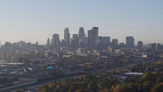 DX0001_002095 - 5.7K stock footage aerial video slowly flyby the city's downtown skyline at sunrise during ascent in Downtown Minneapolis, Minnesota