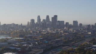 DX0001_002096 - 5.7K stock footage aerial video slowly pass the city's downtown skyline at sunrise in Downtown Minneapolis, Minnesota