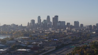 DX0001_002097 - 5.7K stock footage aerial video descending with view of the city's downtown skyline at sunrise in Downtown Minneapolis, Minnesota