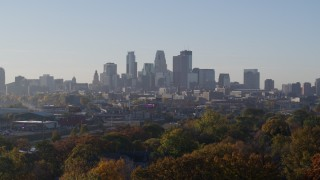 DX0001_002098 - 5.7K stock footage aerial video descend with view of the city's downtown skyline at sunrise in Downtown Minneapolis, Minnesota