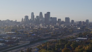 DX0001_002101 - 5.7K stock footage aerial video slow descent with view of city's downtown skyline at sunrise in Downtown Minneapolis, Minnesota