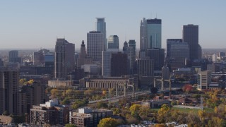 DX0001_002106 - 5.7K stock footage aerial video of skyscrapers in city's skyline seen from condo complex at sunrise in Downtown Minneapolis, Minnesota