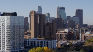 DX0001_002108 - 5.7K stock footage aerial video flyby apartments to reveal condo complex and city's skyline at sunrise in Downtown Minneapolis, Minnesota