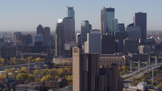 DX0001_002110 - 5.7K stock footage aerial video flyby condo complex with view of city's skyline at sunrise in Downtown Minneapolis, Minnesota