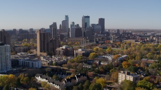 DX0001_002116 - 5.7K stock footage aerial video of city's skyline seen from an apartment building at sunrise in Downtown Minneapolis, Minnesota