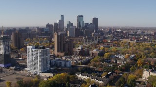 DX0001_002120 - 5.7K stock footage aerial video apartment complex in foreground and skyline in background in Downtown Minneapolis, Minnesota