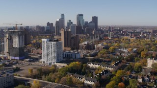 DX0001_002121 - 5.7K stock footage aerial video descend with apartment complex in foreground and skyline in background in Downtown Minneapolis, Minnesota