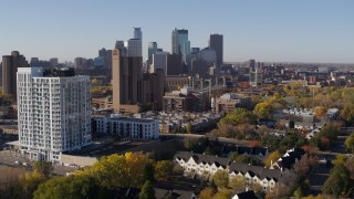 DX0001_002122 - 5.7K stock footage aerial video ascend by apartment complex for view of skyline in Downtown Minneapolis, Minnesota