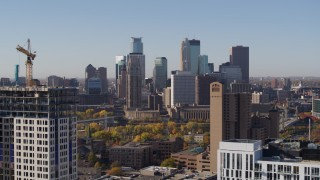DX0001_002126 - 5.7K stock footage aerial video descend and flyby residential buildings with view of skyline at sunrise in Downtown Minneapolis, Minnesota