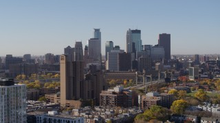 DX0001_002127 - 5.7K stock footage aerial video ascend by residential building with view of skyline at sunrise in Downtown Minneapolis, Minnesota