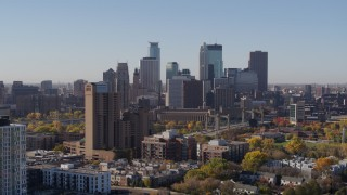 DX0001_002129 - 5.7K stock footage aerial video the downtown skyline seen from residential buildings at sunrise in Downtown Minneapolis, Minnesota