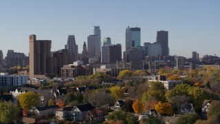 DX0001_002130 - 5.7K stock footage aerial video the downtown skyline seen from residential neighborhood at sunrise in Downtown Minneapolis, Minnesota