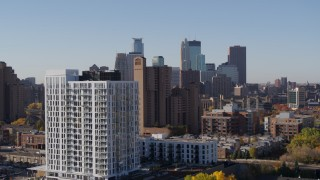 DX0001_002131 - 5.7K stock footage aerial video the downtown skyline seen from residential buildings at sunrise in Downtown Minneapolis, Minnesota