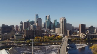 DX0001_002133 - 5.7K stock footage aerial video a view of the skyline from the river in Downtown Minneapolis, Minnesota