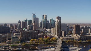 DX0001_002134 - 5.7K stock footage aerial video a view of the skyline while ascending by the river in Downtown Minneapolis, Minnesota