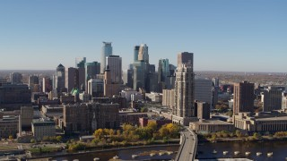 DX0001_002135 - 5.7K stock footage aerial video slowly flying by the skyline, seen from the river in Downtown Minneapolis, Minnesota