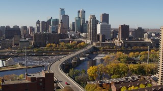 DX0001_002148 - 5.7K stock footage aerial video descend near a bridge spanning the river with view of the skyline, Downtown Minneapolis, Minnesota