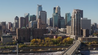 DX0001_002149 - 5.7K stock footage aerial video flying by the skyline on the other side of the Mississippi River, Downtown Minneapolis, Minnesota