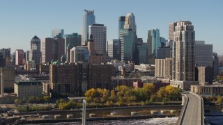 DX0001_002151 - 5.7K stock footage aerial video pass by the skyline on the other side of the Mississippi River, Downtown Minneapolis, Minnesota