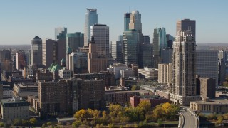 DX0001_002153 - 5.7K stock footage aerial video flying by the city's skyline, seen from opposite side of the river, Downtown Minneapolis, Minnesota