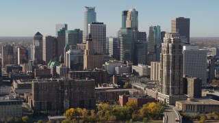 DX0001_002156 - 5.7K stock footage aerial video pass by the city's skyline during descent, seen from the river, Downtown Minneapolis, Minnesota