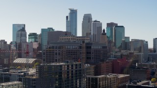 DX0001_002157 - 5.7K stock footage aerial video flying by office building with view of the city's skyline during ascent, Downtown Minneapolis, Minnesota