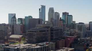 DX0001_002158 - 5.7K stock footage aerial video reverse view of office building and city's skyline, Downtown Minneapolis, Minnesota