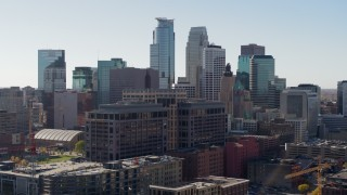 DX0001_002160 - 5.7K stock footage aerial video flyby office building and city's skyline, Downtown Minneapolis, Minnesota