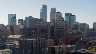 DX0001_002161 - 5.7K stock footage aerial video descend near office building and city's skyline, Downtown Minneapolis, Minnesota