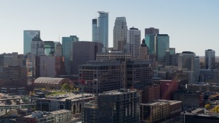 DX0001_002163 - 5.7K stock footage aerial video descend near office building and city's skyline before flyby, Downtown Minneapolis, Minnesota