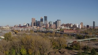 DX0001_002166 - 5.7K stock footage aerial video ascend from park to approach the skyline of Downtown Minneapolis, Minnesota